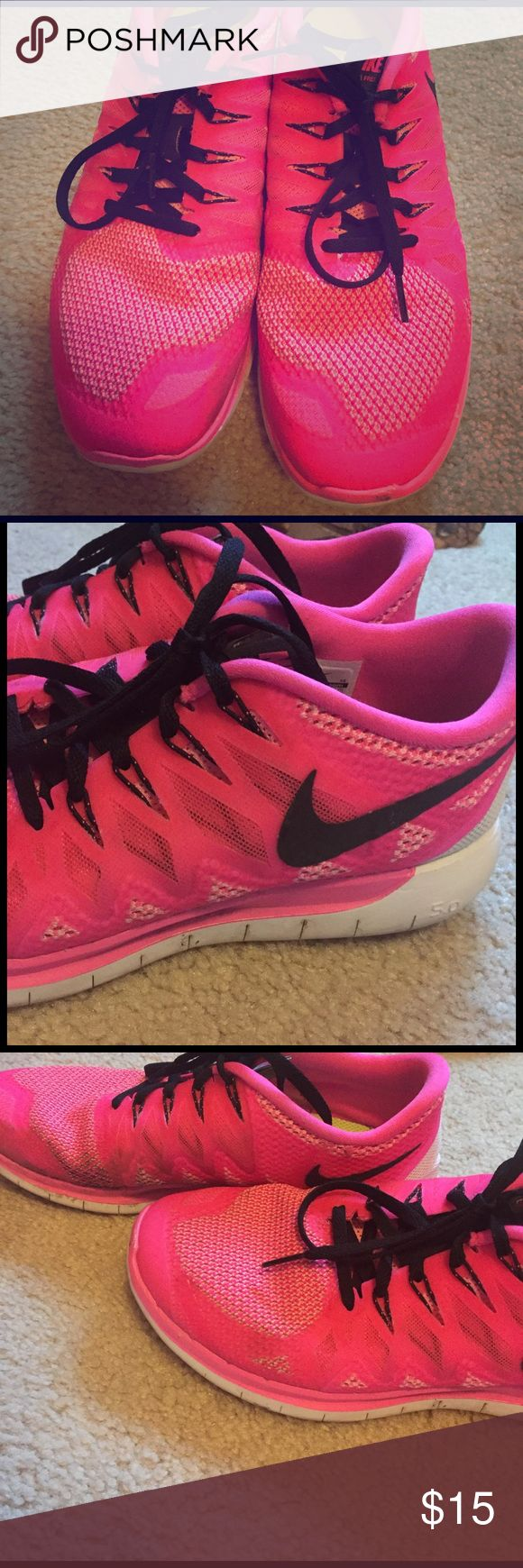 Nike Free running shoes Pink running shoes, very comfy, worn, stain on right shoe but still have a lot of life left in them! Nike Shoes Athletic Shoes