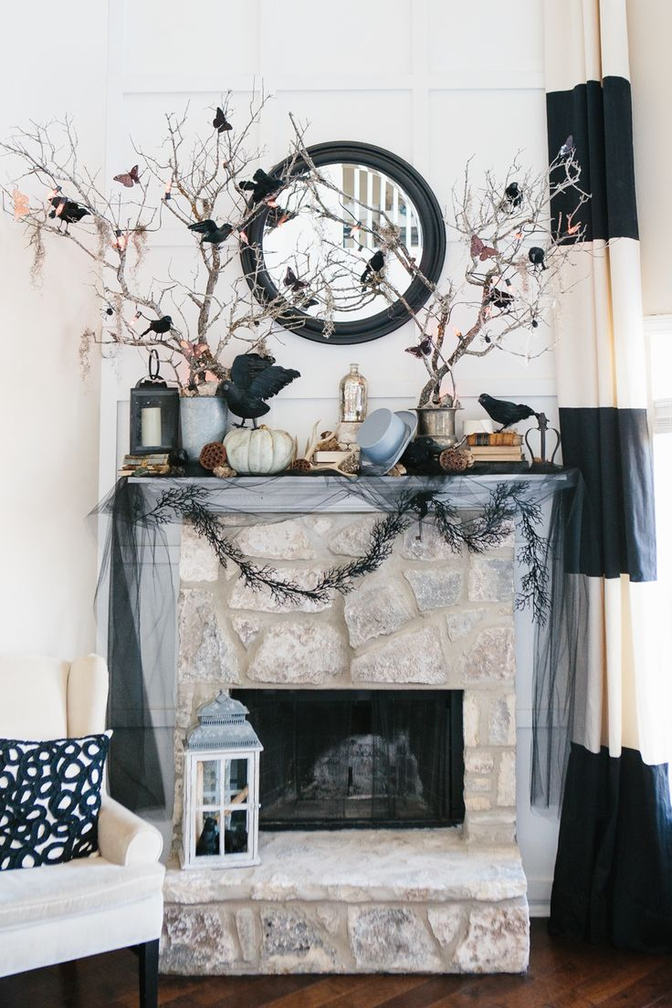 20 Spooktacular Halloween Mantels  l  Black & White horizontal striped curtains, scribble pattern pillow and white pumpkins with black crows.