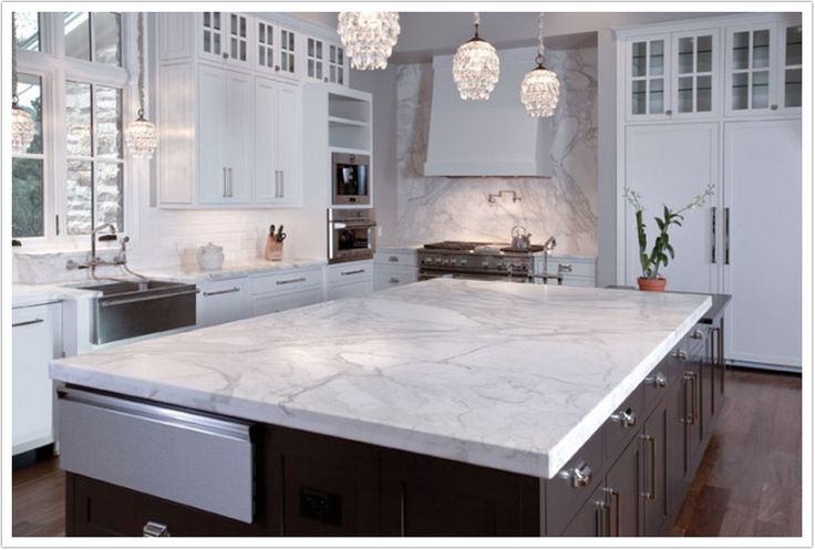 Torquay Quartz by Cambria is made up of a white base with black…