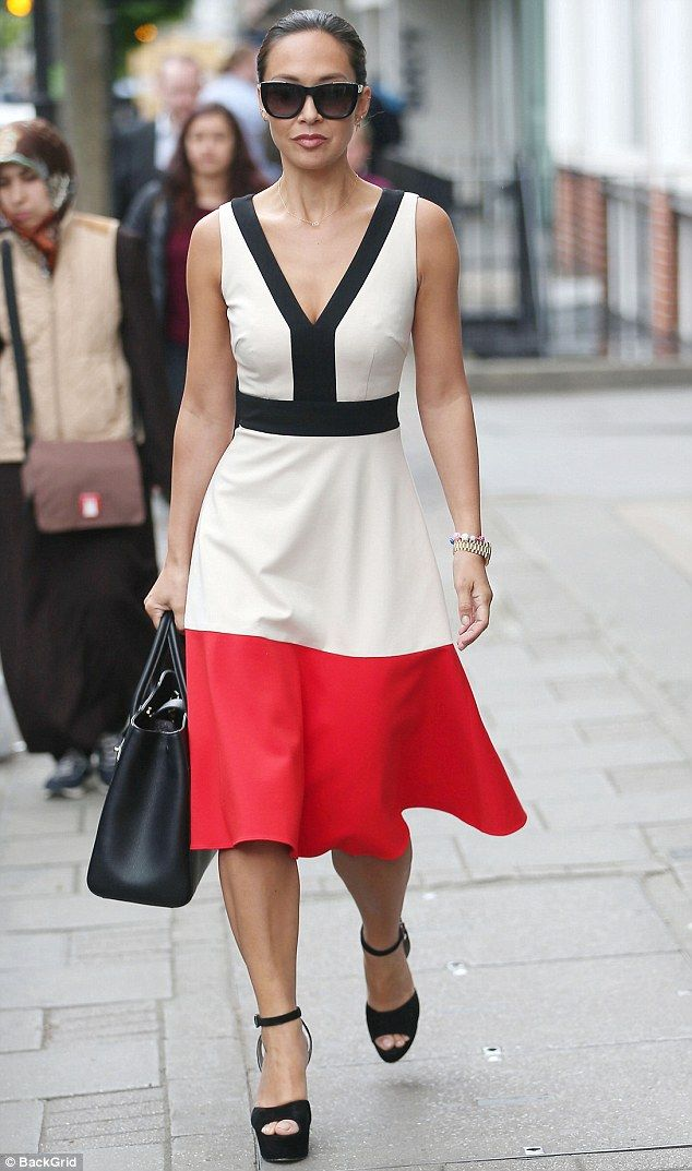 Painting the town red: The classical pianist was the picture of class in the summery white frock, which featured a bold and stylish scarlet panel at the hem