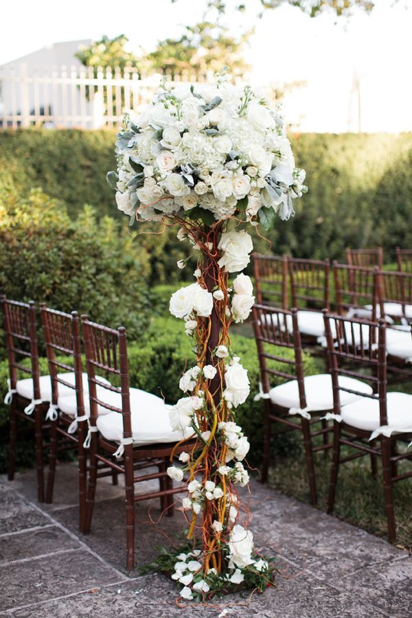 Pretty branch wedding ceremony decor Photo by