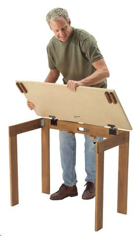 Descriptive details on how to make a small folding table that would be easy to create and use for displays More