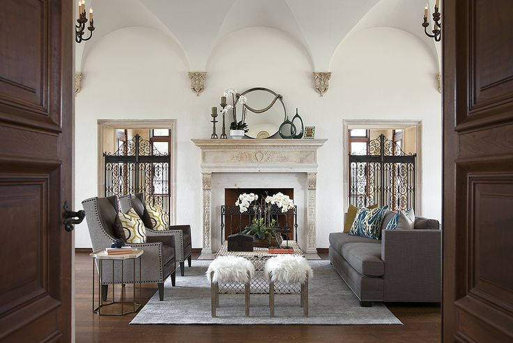 A Beautiful Vaulted Ceiling Soars Above A Transitional