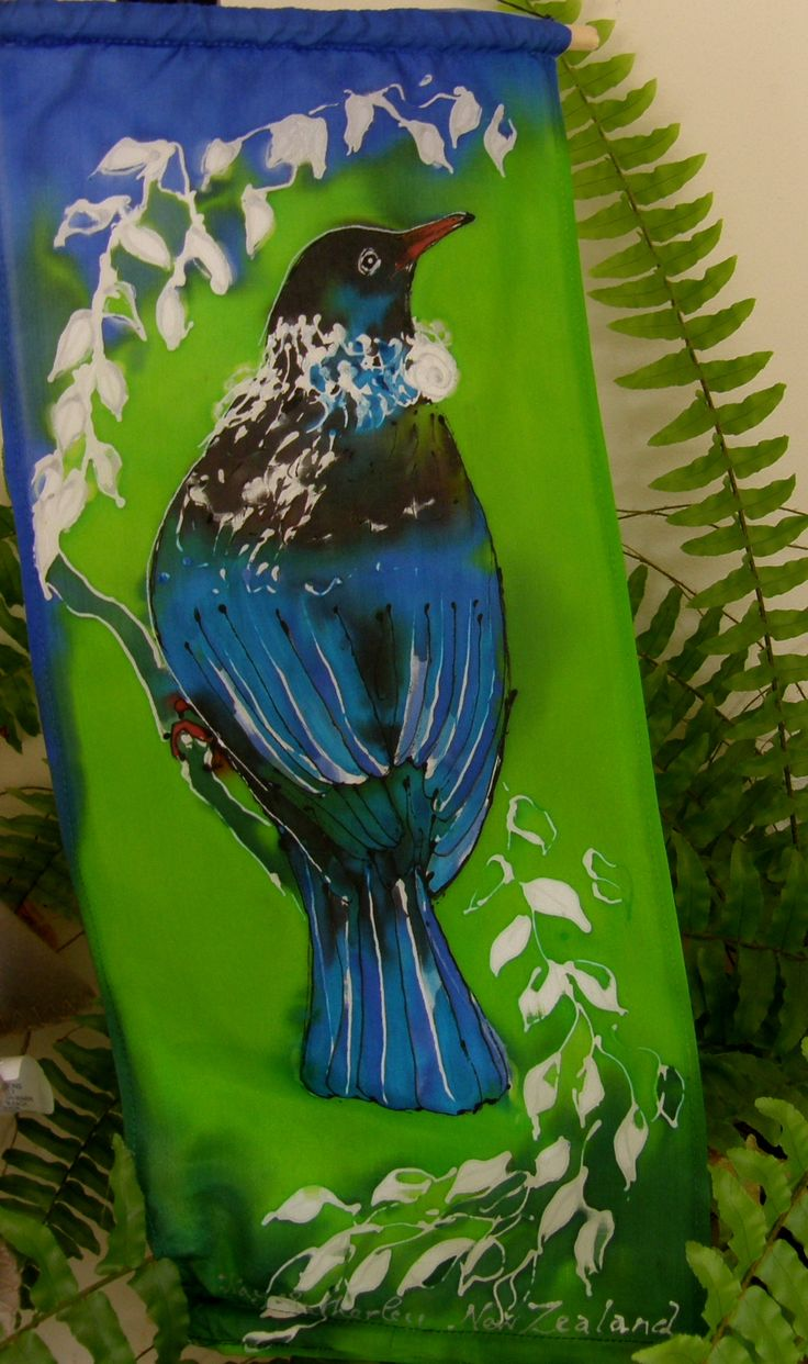 NZ Gifts. Tuis amongst the Tree Ferns!!. Well,they are still frolicking and singing even in winter, in our garden. This one , however is a Handpainted Silk Wall Hanging nesteled in a fern pot plant www.satherleysilks.co.nz