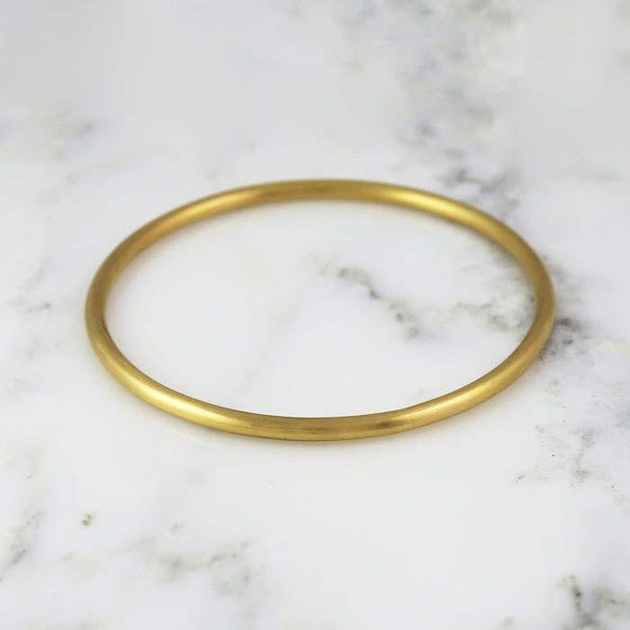 3.25mm Full Round Solid Gold Bangle Bracelet - Simple Gold Bracelet - 3mm Bangle - 10k 14k 18k 22k by HoardJewelry on Etsy https://www.etsy.com/listing/290262983/325mm-full-round-solid-gold-bangle