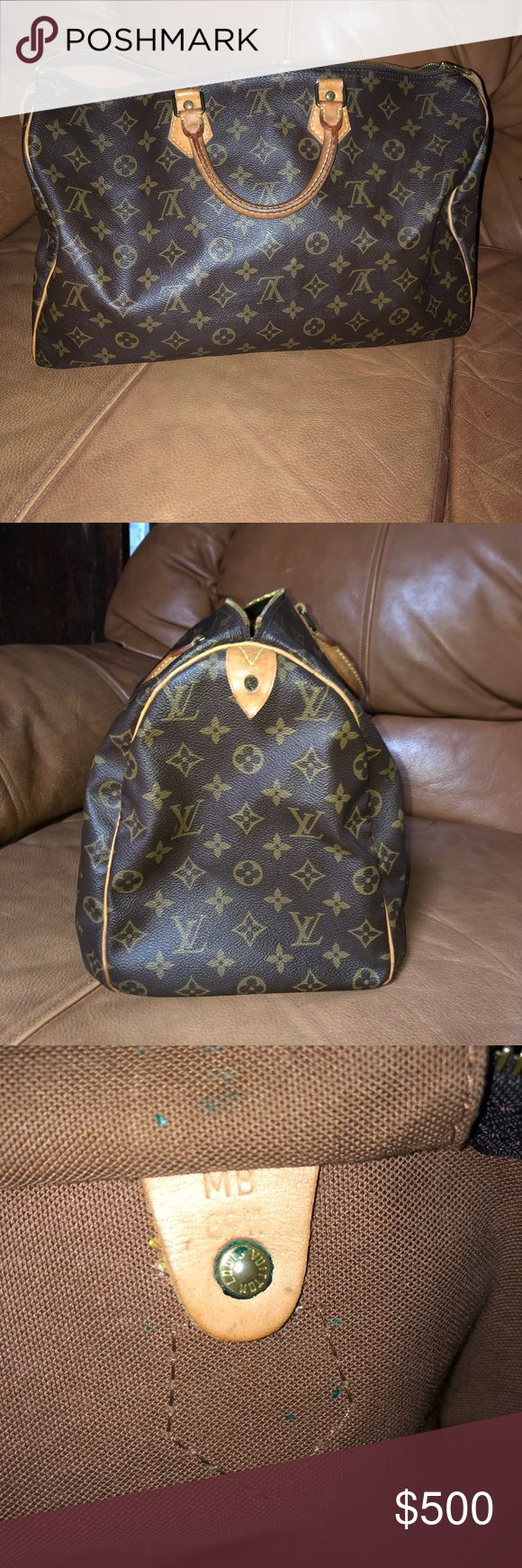 Louis Vuitton Authentic Speedy 40 Lovely Authentic Louis Vuitton Speedy 40 in beautiful condition. Date code is 8911. No stains except for a couple tiny spots on inside bottom. No rips, or tears. No odor noted. Very clean. Purchased from a fellow posher and never worn. Characteristic vachetta and patina reflect time and use of classic aged leather. Louis Vuitton Bags Totes