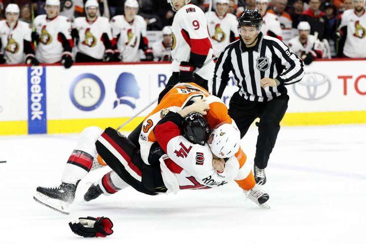 TAKE DOWN  -    The Flyers' Radko Gudas gets into a fight with the Senators' Mark Borowiecki on March 28 in Philadelphia, Pennsylvania. The Flyers won 3-2.