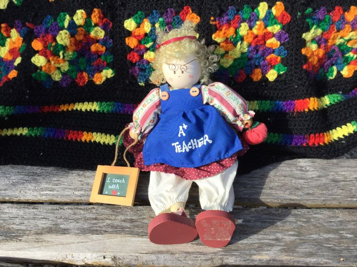 A personal favorite from my Etsy shop https://www.etsy.com/listing/490563069/vintage-wooden-doll-teacher-a-teacher