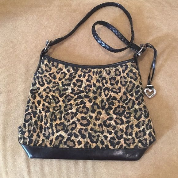 "Brighton animal print shoulder bag 12"" at its widest near bottom, 9"" height. 15"" shoulder strap drop. Gently pre-loved. Open interior, zip slot on one side. Snap closure.small spot on bottom as shown. Brighton Bags Shoulder Bags"