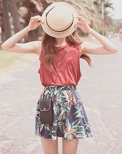.summer love. tropical floral patterned skirt. muscle tee. and adorable hat.