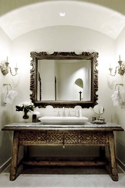 Interiors by Sandra Espinet. The carved Indonesian table which was utilized as a vanity in this bath.