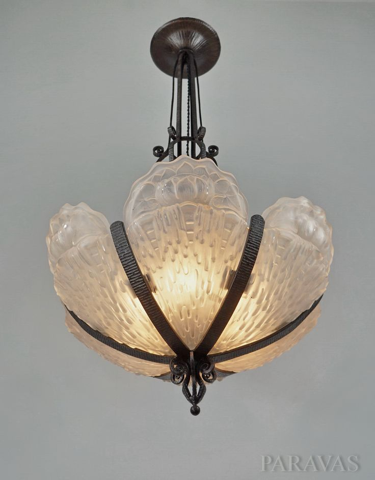 French 1930 art deco chandelier in wrought iron holding six large panels in moulded pressed glass made by Val Saint Lambert. (paravas-ebay)