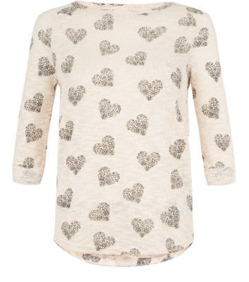 Give casual staples a romantic twist with this pink heart print top. £14.99.