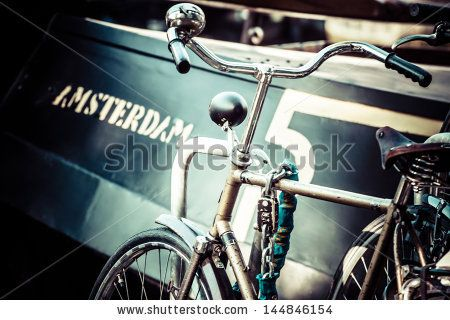 Amsterdam canal and bikes by Curioso, via ShutterStock