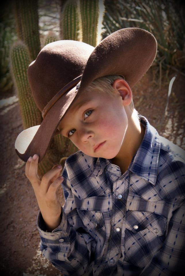 Joshua does his cowboy hat like this a lot when he wears it. He thinks he's a real cowboy...cute.