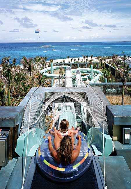 Paradise Island-Bahamas: a new 63 acre water park with a habitat for rescued dolphins and a lazy river that lets you ride an inner tube to the top of a 120 foot tall waterslide complex