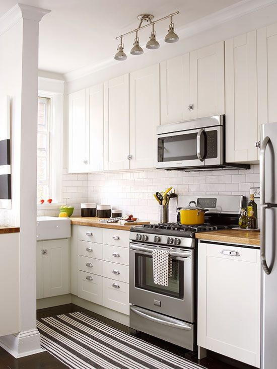 Check out how these small white kitchens pack a punch: http://www