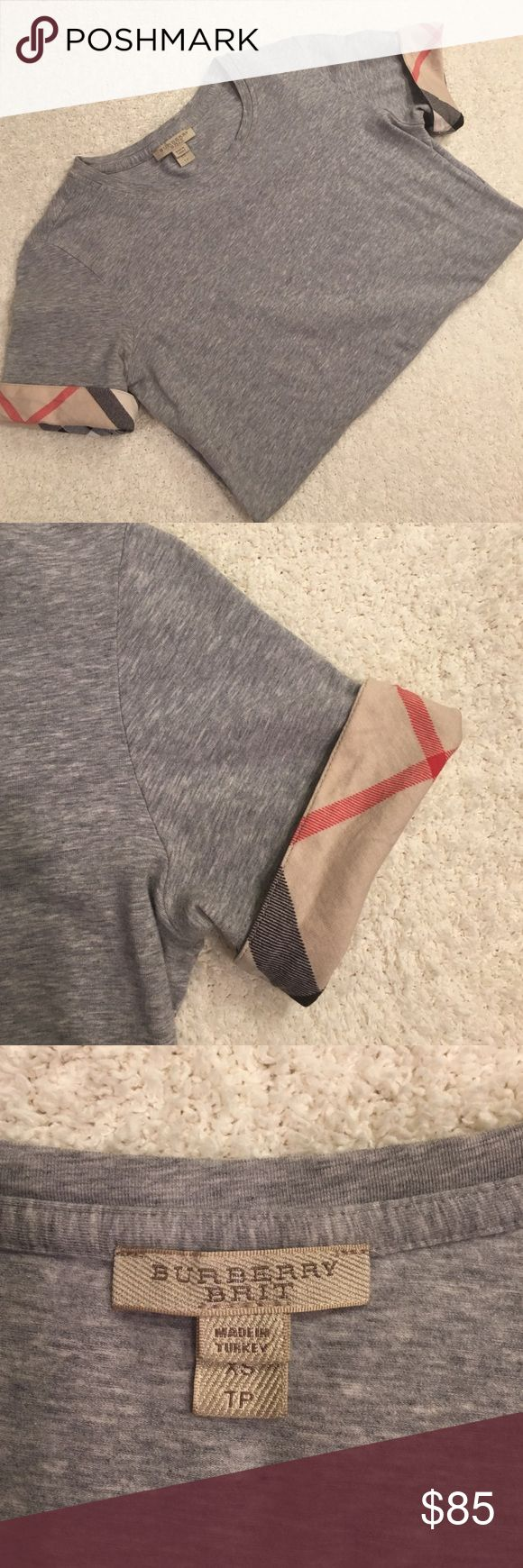 Burberry tee Grey Burberry t-shirt. Has signature plaid detailing on both sleeves. In excellent condition only worn once or twice. Size XS. The material is 93% cotton and 7% elastane. Burberry Tops Tees - Short Sleeve