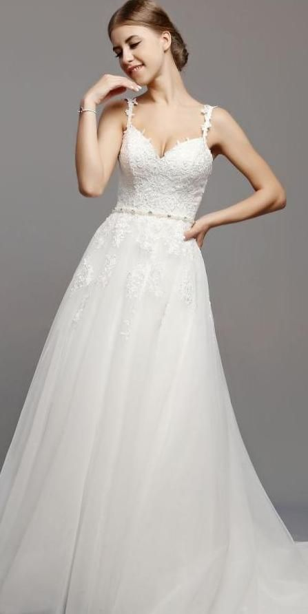 BB1444. Beautiful sweetheart neckline. Lace applique through bodice and top of skirt. Intricate beaded detail on waistline