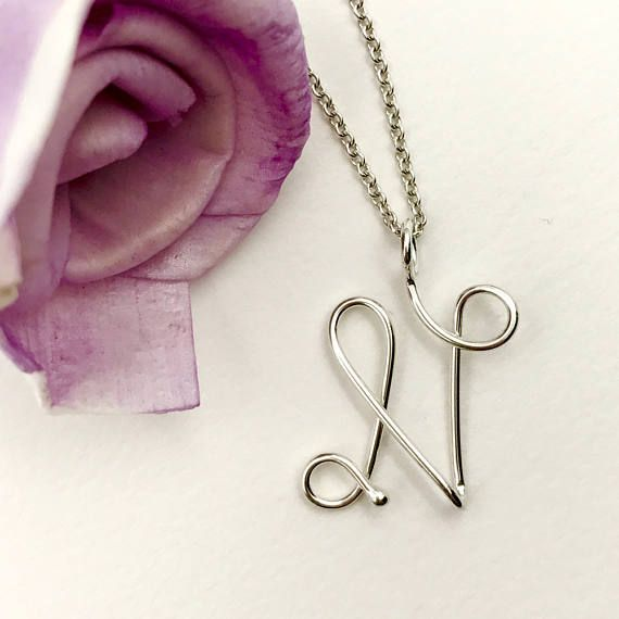 Cursive letter N initial pendant necklace. Letters A-Z available. Perfect everyday necklace or makes a great gift!