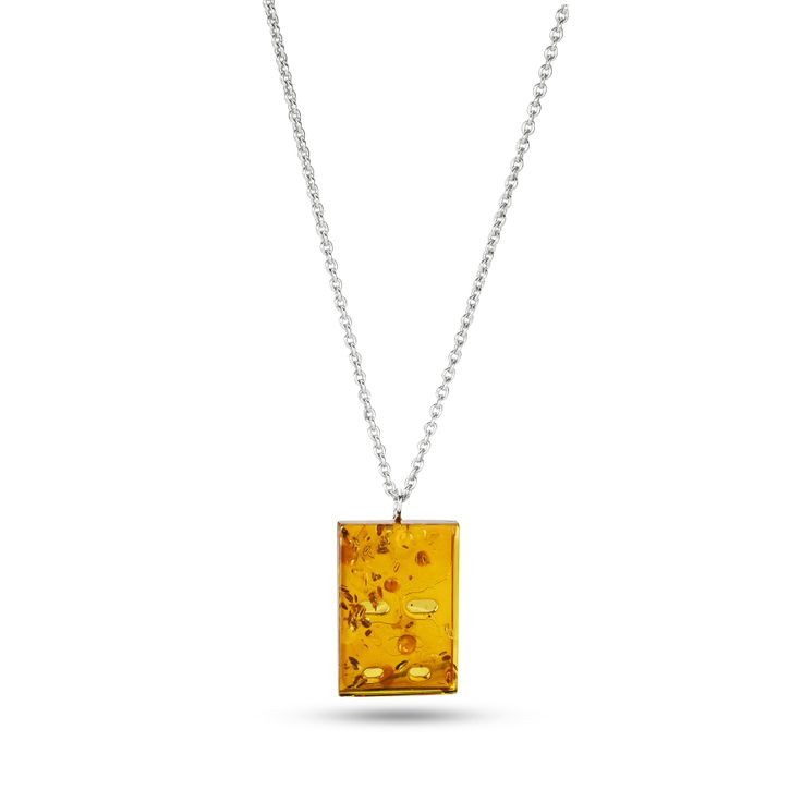 House of Amber by Louise Sigvardt - Silver pendant with amber piece.