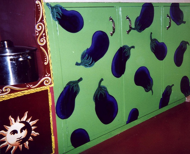 My aubergine pot cupboards.I used a deglosser on the parts i painted and then sealed each with a gloss finish