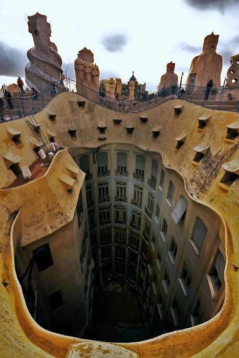 And this....  View of the roof around the atrium of La Pedrera in Barcelona, Spain. Completed in 1912 and designed by Catalan architect Antoni Gaudí