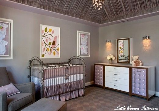 Love the sconces, dresser, chandelier, and wall art above the crib.