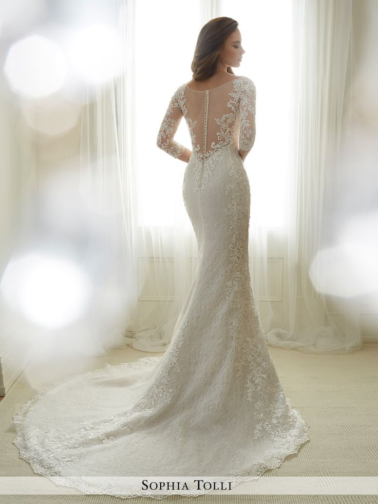 Sophia Tolli - Y11702 Gabrielle - Allover sequin lace and light tulle soft trumpet gown generously adorned with lace appliqués features illusion and lace three-quarter length sleeves, plunging V-neckline with sheer peekaboo concealed with lace, illusion back features matching appliqués and zipper trimmed with diamante buttons, scalloped lace hemline, chapel length train.Also available with a 3 inch raised back neckline as Y11702HB.Sizes: 0 - 28Colors: Ivory/French Beige, Ivory, White