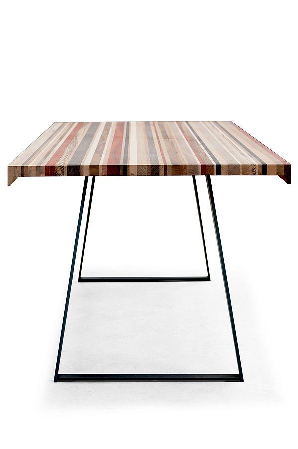 """Offcut è un tavolo di design in legno di recupero con base in ferro. Legno di recupero significa realisticamente """"avanzo di lavorazione"""", e una serie di avanzi accuratamente selezionati hanno dato vita a questo tavolo.  Alla varietà di colori naturali, mantenuti tali da una speciale finitura che blocca il processo di ossidazione del legno si contrappone l'essenzialità della base in ferro. Il tavolo Offcut rappresenta un arredo di grande stile, unico e irripetibile."""