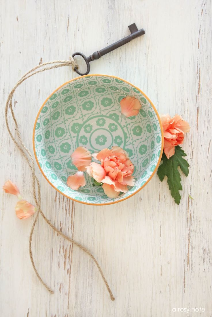 great color combo - mint and peach styling of a bowl on old white washed wood background