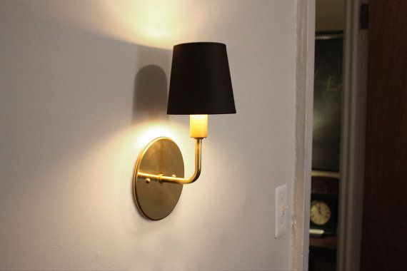 Elegant brass sconce.  Dean.  Transitional wall lighting.  Hollywood Regency sconce.  Modern Scandinavian light.