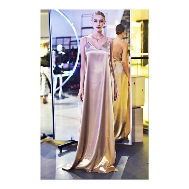 With a never-goes-out-of-style design and color this satin slip dress by Laura Lazar is the perfect embodiment of 90's iconic aesthetic, while the skin-baring back and flirtatiously high side slit combine for a daring look. Slip dress. Golden. Evening wear.
