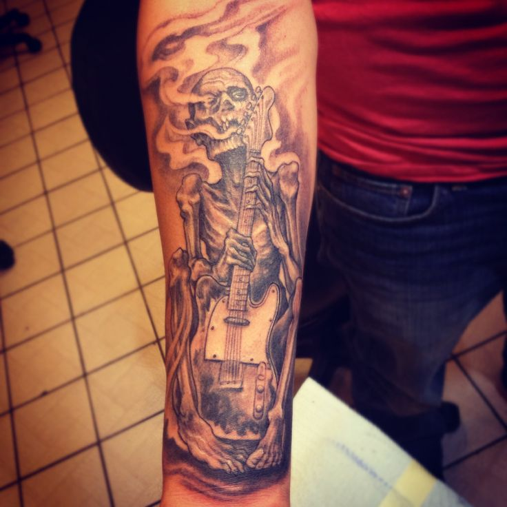 zombie guy with his fender guitar tattoo by ray jerez