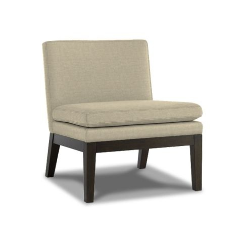 Even if you have a large sofa, a neutral slipper chair can add style and extra seating.