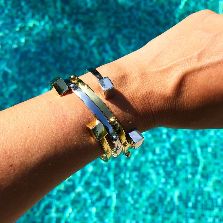 Stacking gold & silver bangles to get the summer started.