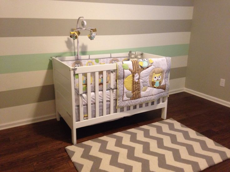 Emilio's nursery. My baby nursery :) Grey, yellow and mint green owls. Stripes wall.