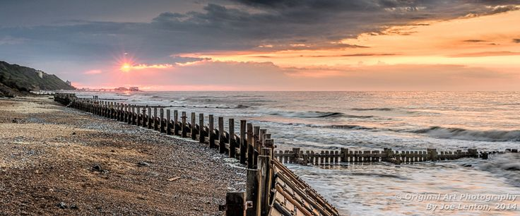 This landscape photo was taken from Overstrand beach in Norfolk looking towards Cromer Pier with the sun setting behind it. The image won highly commended in the Societies July 2014 Landscapes competition