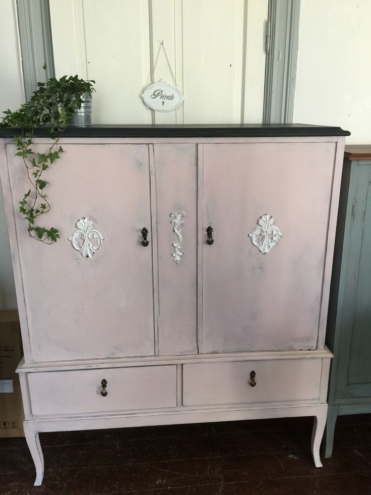 A vintage cabinet painted in pink and black. By Vintage & Färg in Sweden.