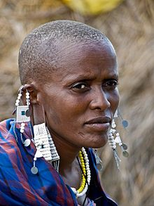 Maasai women hang everything & anything from their ears! Some even hung bicycle reflectors, & had long stretched out ear lobes!