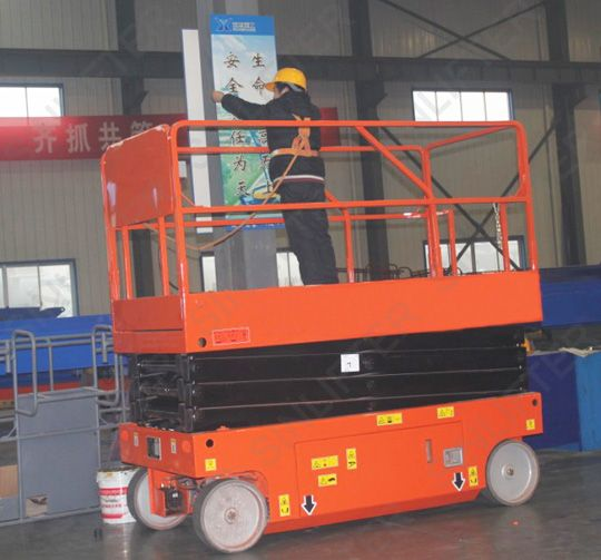 Electric elevated work platform is able to drive itself from one site to another site by battery power. This unit with 8m height, 450kg capacity. Click here to learn more: http://sinolifter.com/self-propelled-scissor-lift/electric-elevated-work-platform-8m.html