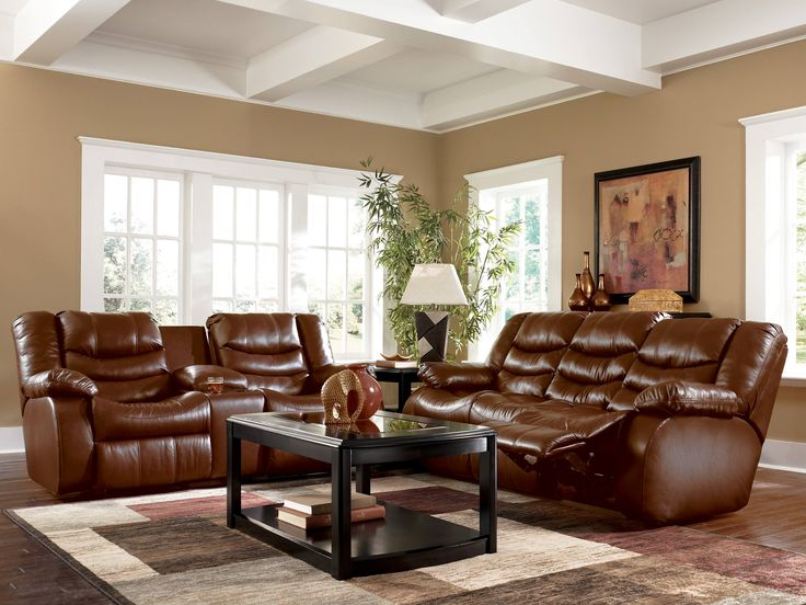 Living Room with Brown Couches - I like the white around the windows with  the tree - 33 Best Images About Dark Furniture DeCor On Pinterest Leather
