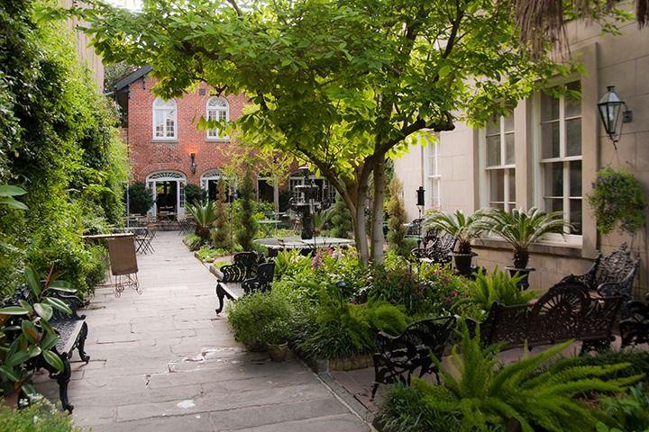 French Quarter courtyard garden rooms serve as anterooms