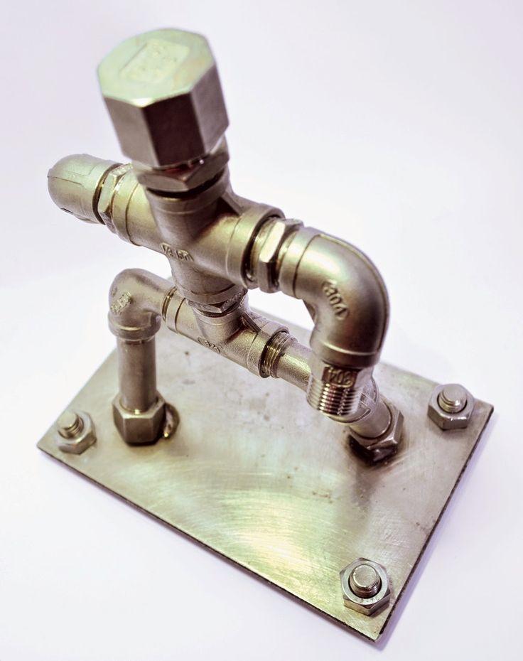 Industrial art inox figure made of metal pipe fittings