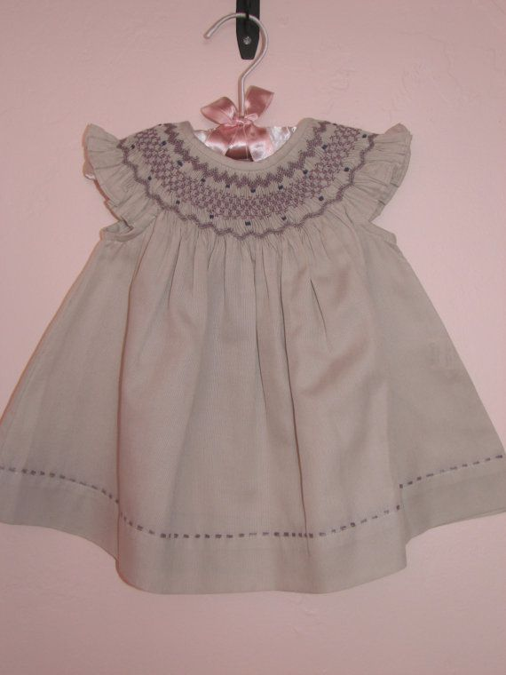 Smocked baby bishop with angel sleeves