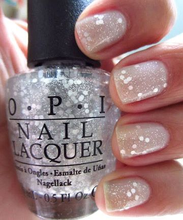 OPI Nail Lacquer in Pirouette My Whistle layered over OPI My Pointe Exactly gives your nails the subtlest amount of sparkle to complement your shiny new wedding ring.