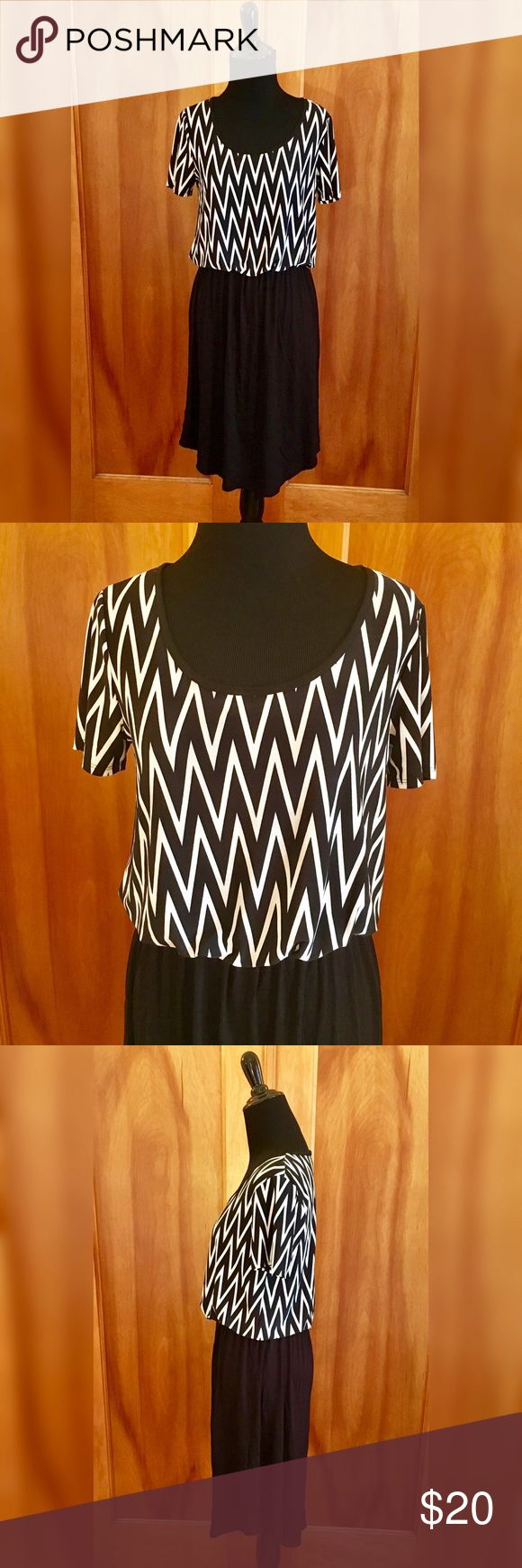 Saint Paradise black & white chevron dress Dress with a black and white chevron top and solid black bottom. Brand is Saint Paradise, purchased through Zulily. New without tags. Recommended for someone with a longer torso. Nice and light for summer! Saint Paradise Dresses