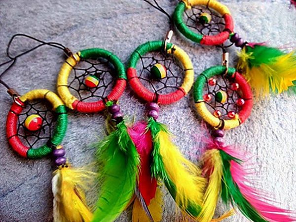 Keychain Small (Rasta Design)  ₱ 75.53 – color yellow, green, and red – 1 line feather and pendant  Link: http://www.our7107islands.com/product/keychain-small-rasta-design/  #livefair #lifthumanity #philippineartisans #our7107islands #wearFilipino #lovewithacause #philippines #handmade #handicrafts #dreamcatchers #keychains #rasta