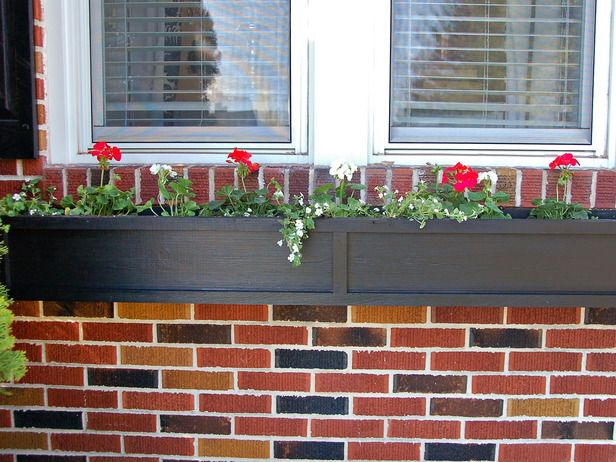 I want to make a window box for flowers.  It would look perfect on the back patio.  I can picture red geraniums already!