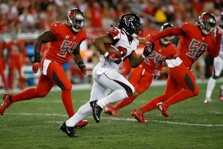 Thursday Night Football: Falcons vs. Buccaneers:  43-28, Falcons  -  November 3, 2016  -    Running back Devonta Freeman #24 of the Atlanta Falcons evades outside linebacker Lavonte David #54 of the Tampa Bay Buccaneers and middle linebacker Kwon Alexander #58 as he runs for a first down during the first quarter of a game on Nov. 3, 2016 at Raymond James Stadium in Tampa, Florida.